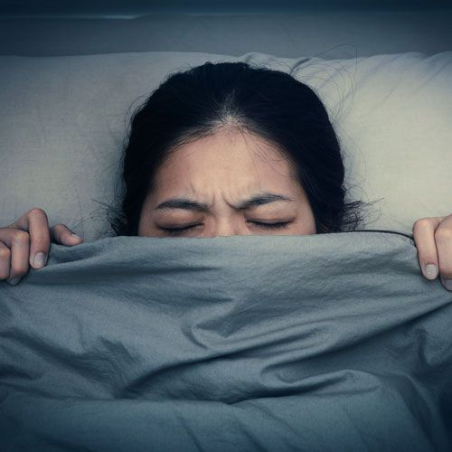 Woman suffering from nightmares