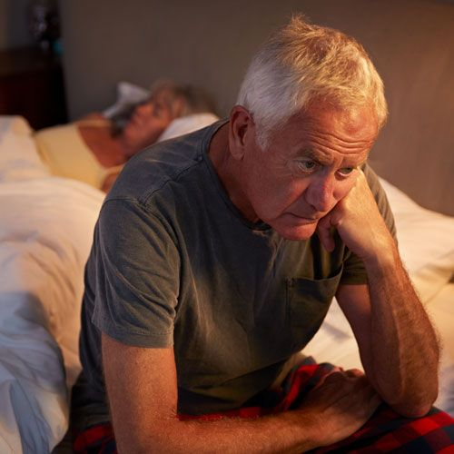 Older man suffering from restless leg syndrome